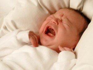 Крик новорожденного при раздражителях